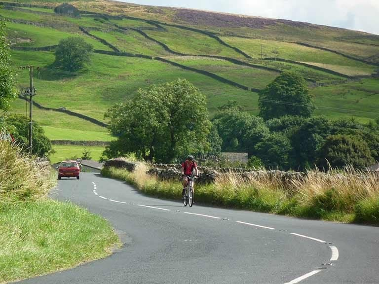 A cyclist tackles the terrain in the English Lake District