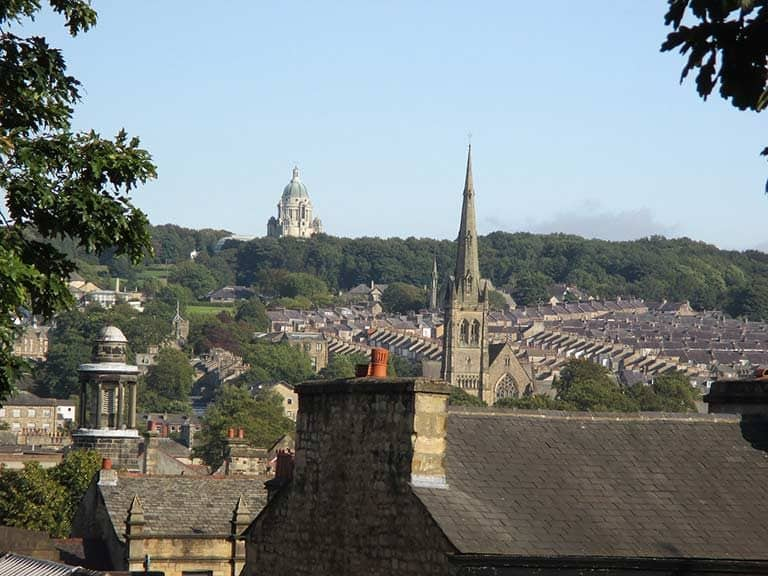 The Ashton Memorial and rooftops of Lancaster in Lancashire